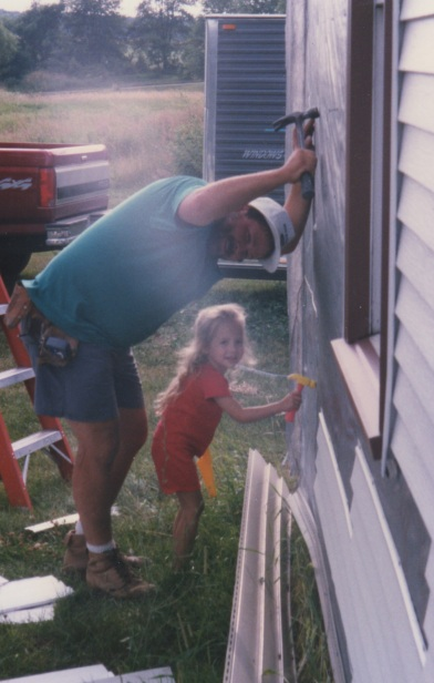 "Dad and I ""building"" the house together"